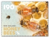 The $1.90 stamp shows young worker 'house bees' transferring nectar to the honey storage area inside the hive.