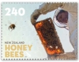 The $2.40 stamp shows beekeepers removing the combs from  the hives to harvest the honey.