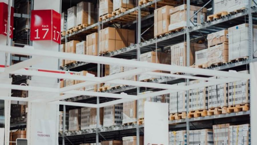 interior view of a warehouse with tall pallet racks holding a large amount of stock