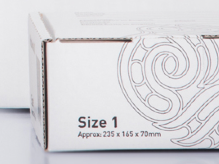 "Small white cardboard box with a Maori design and ""Size One"" printed on it"