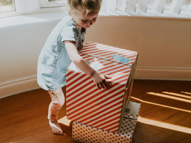 Toddler with a parcel